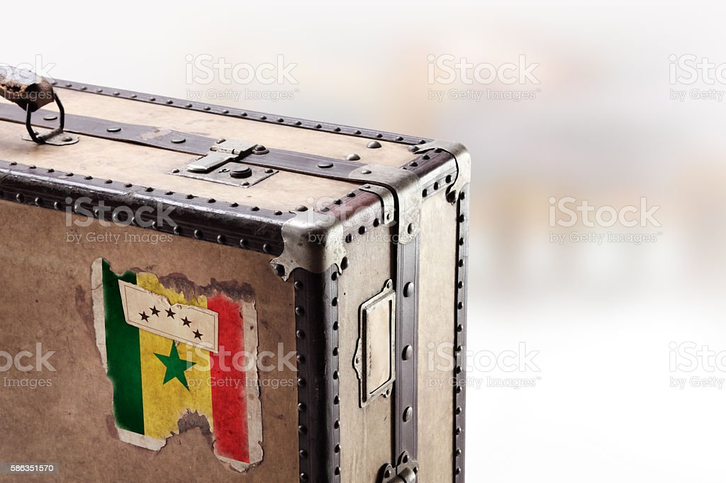 Old leather suitcase with flag of Senegal stock photo