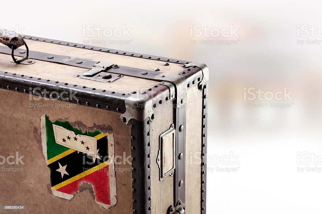 Old leather suitcase with flag of St. Kitts and Nevis stock photo