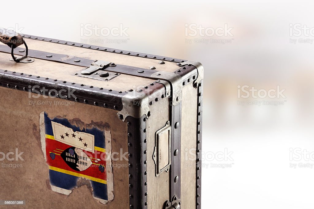 Old leather suitcase with flag of Swaziland stock photo