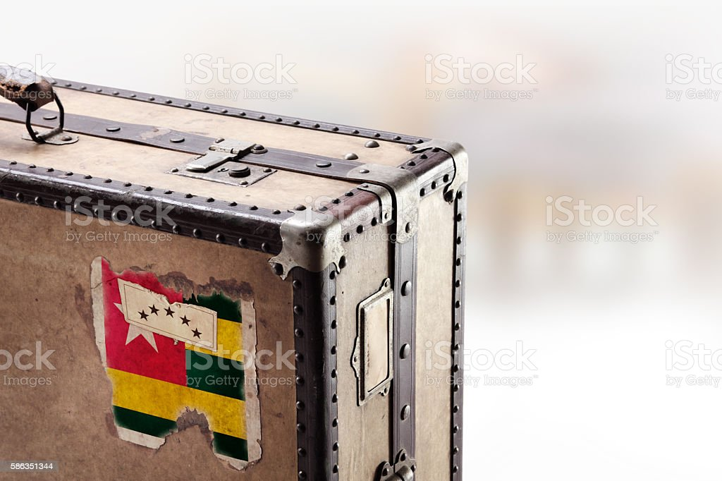 Old leather suitcase with flag of Togo stock photo