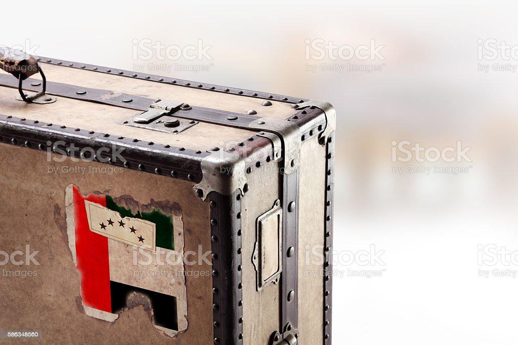 Old leather suitcase with flag of United Arab Emirates stock photo