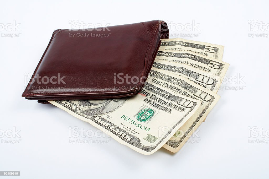 Old leather wallet with bills inside royalty-free stock photo