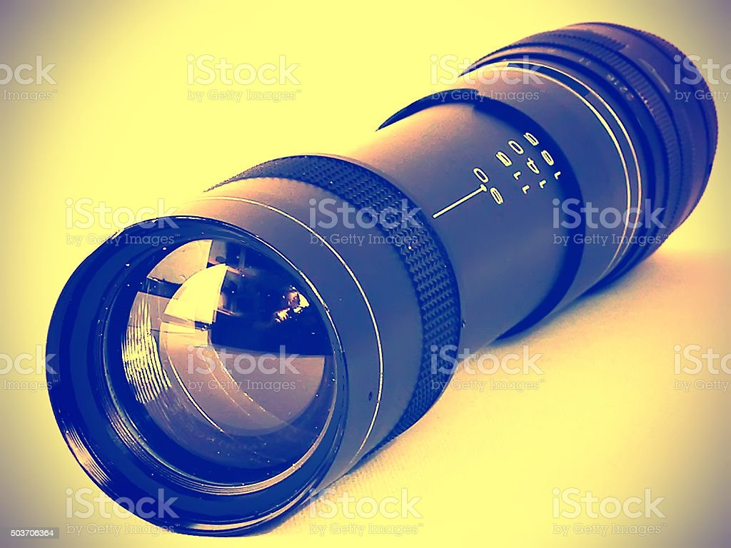 Old lens with variable focal length stock photo
