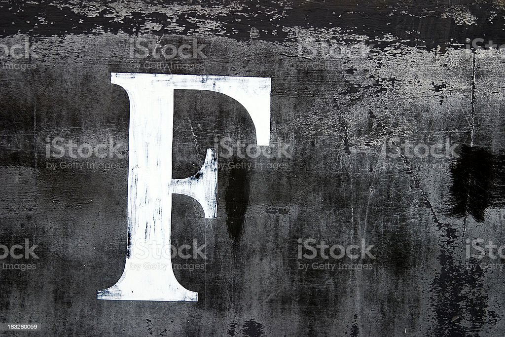 Old letter F royalty-free stock photo