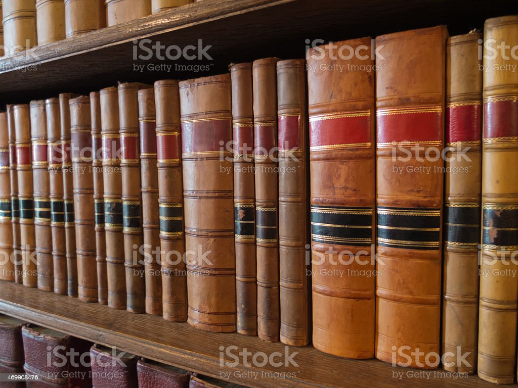 old books on shelves in library