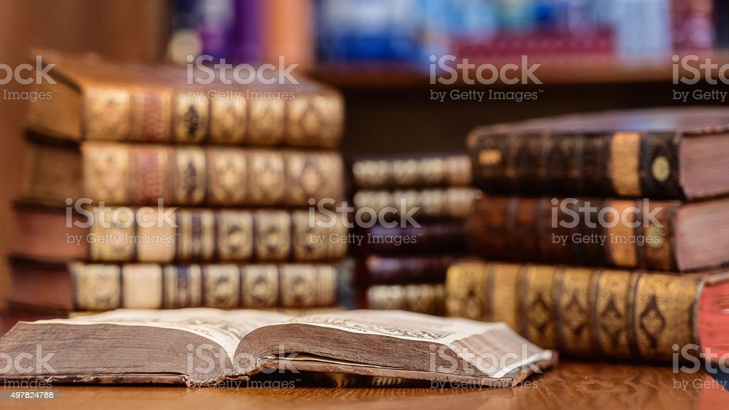 Old library of vintage hard cover books stock photo
