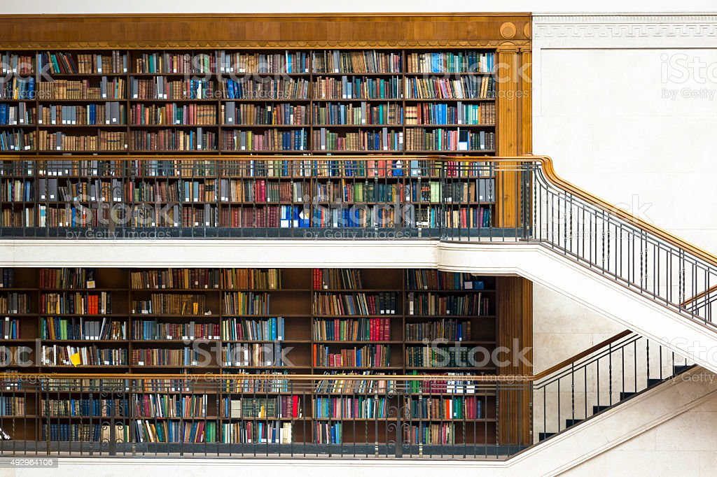 Old library with staircase and shelfs with books, copy space stock photo