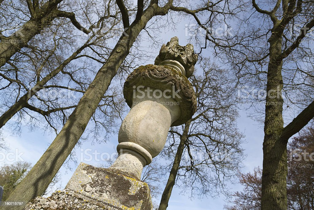 Old lichen-covered decorative stone statue royalty-free stock photo