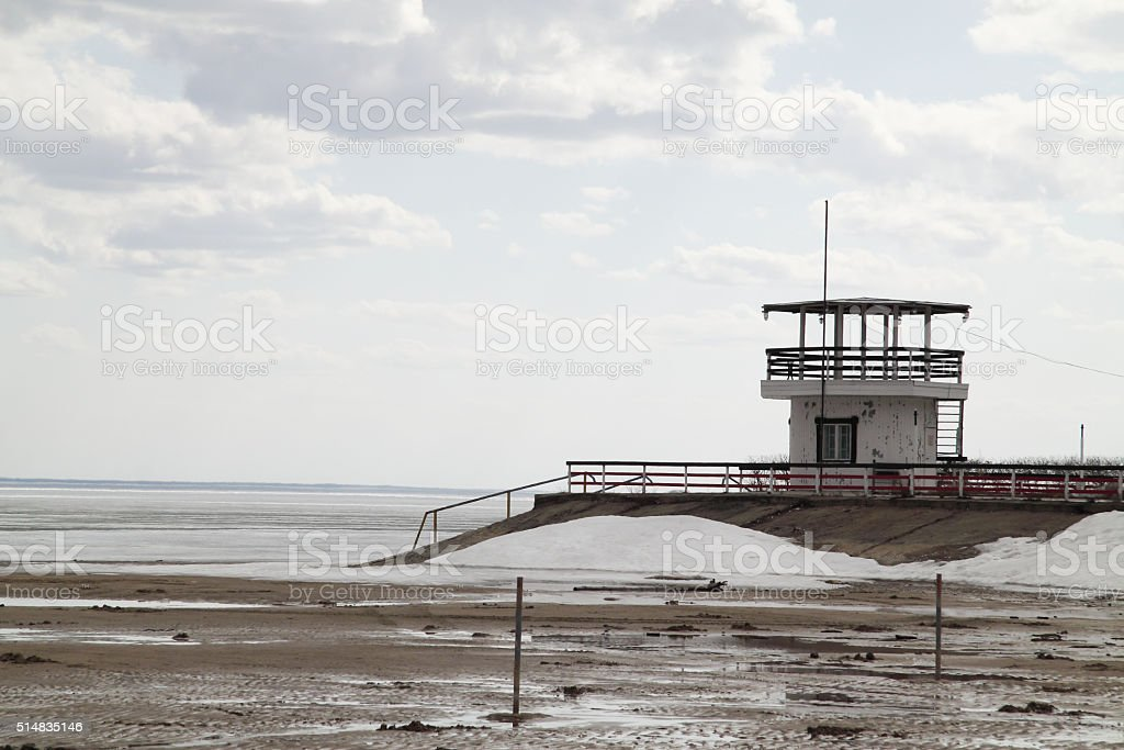 old lifeboat station on the beach stock photo