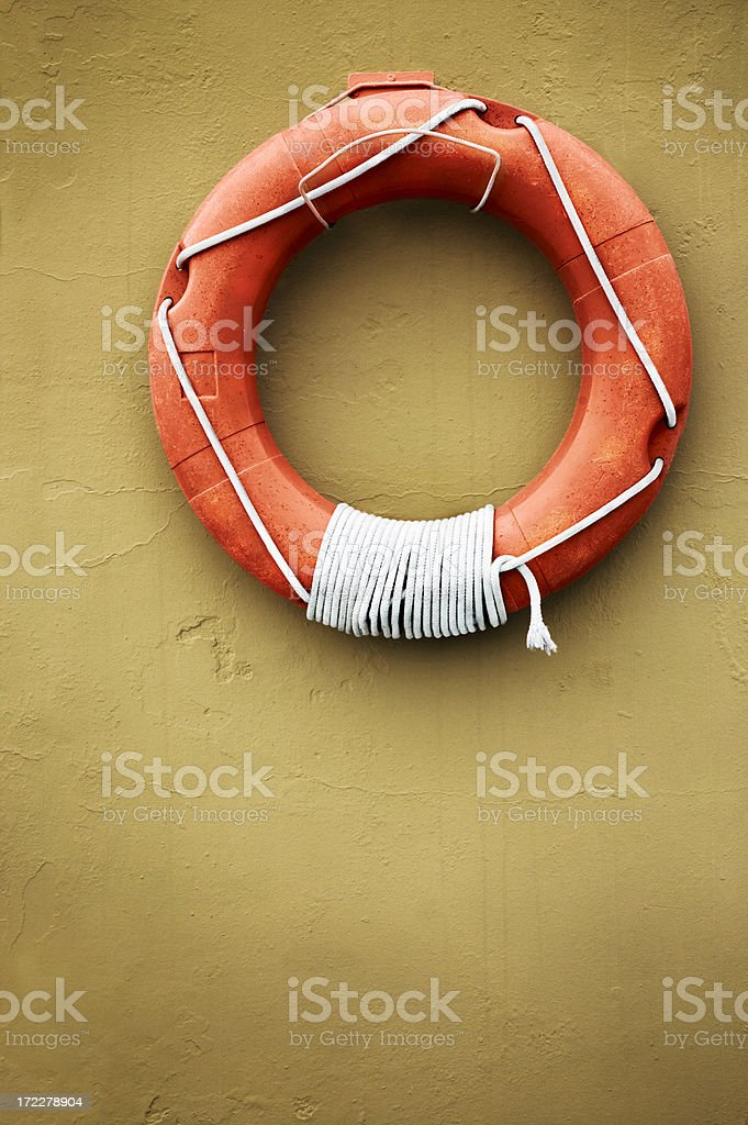 Old lifesaver on a wall royalty-free stock photo