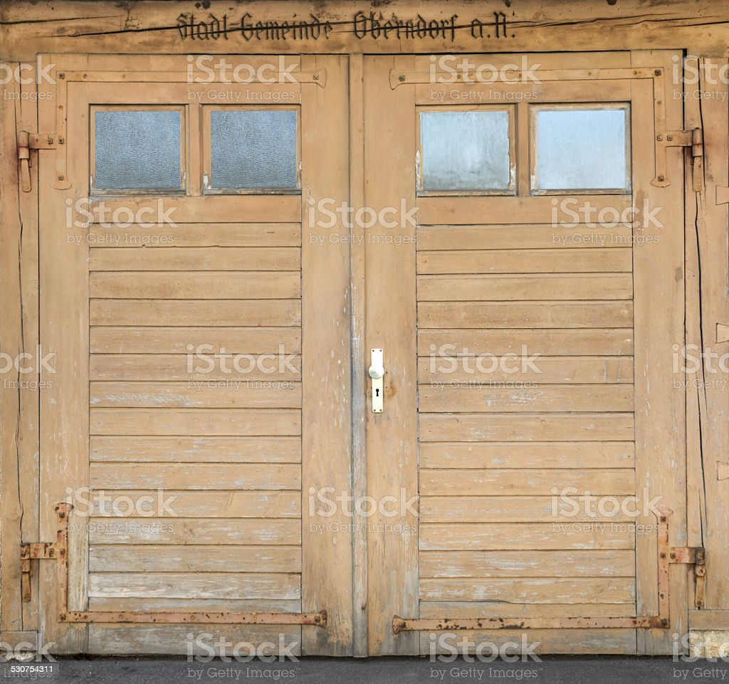Old light brown garage door with windows royalty-free stock photo
