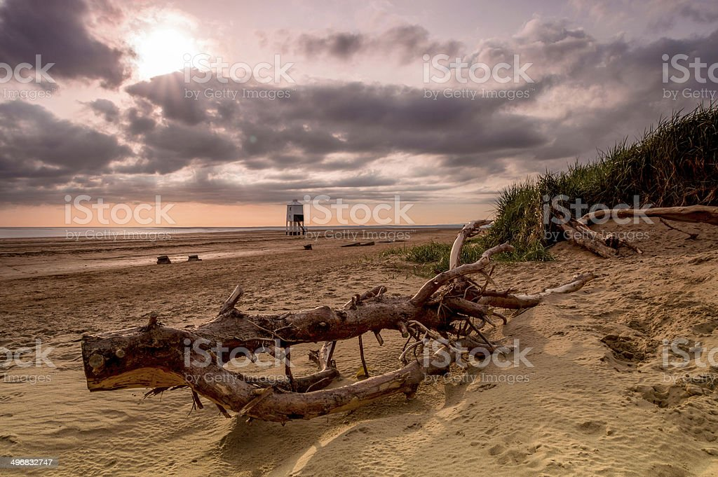 old lighthouse on legs, beach shot, England stock photo