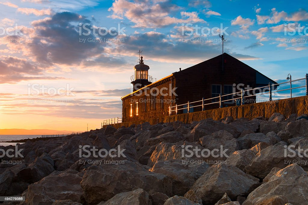 Old lighthouse on the pier in Moracambe stock photo