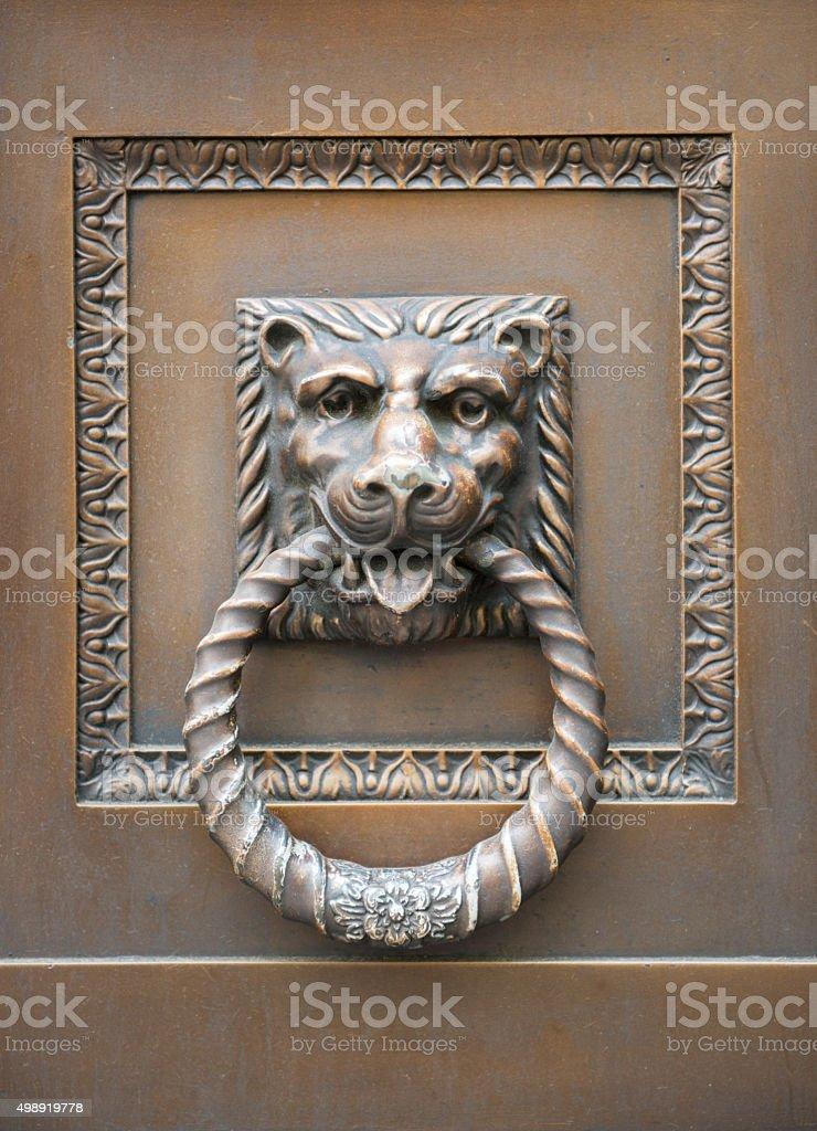 Old Lion Head Doorhandle in London stock photo