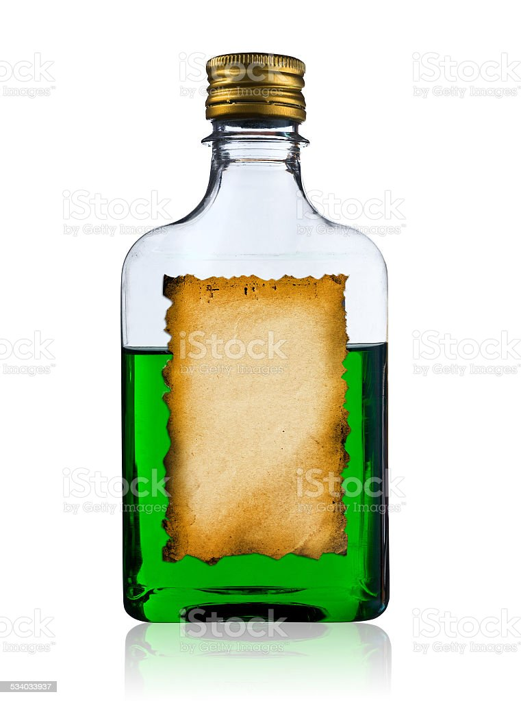 Old liquor bottle with label. stock photo