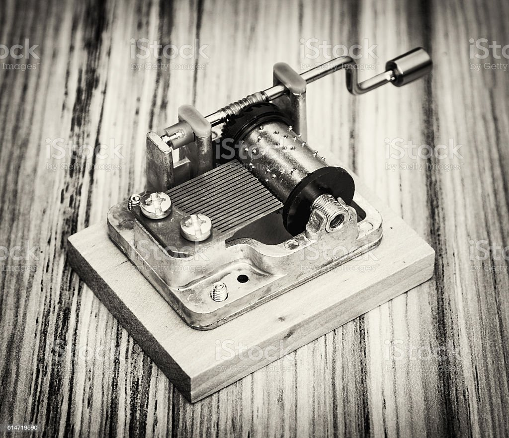 Old little music box on the wooden background stock photo