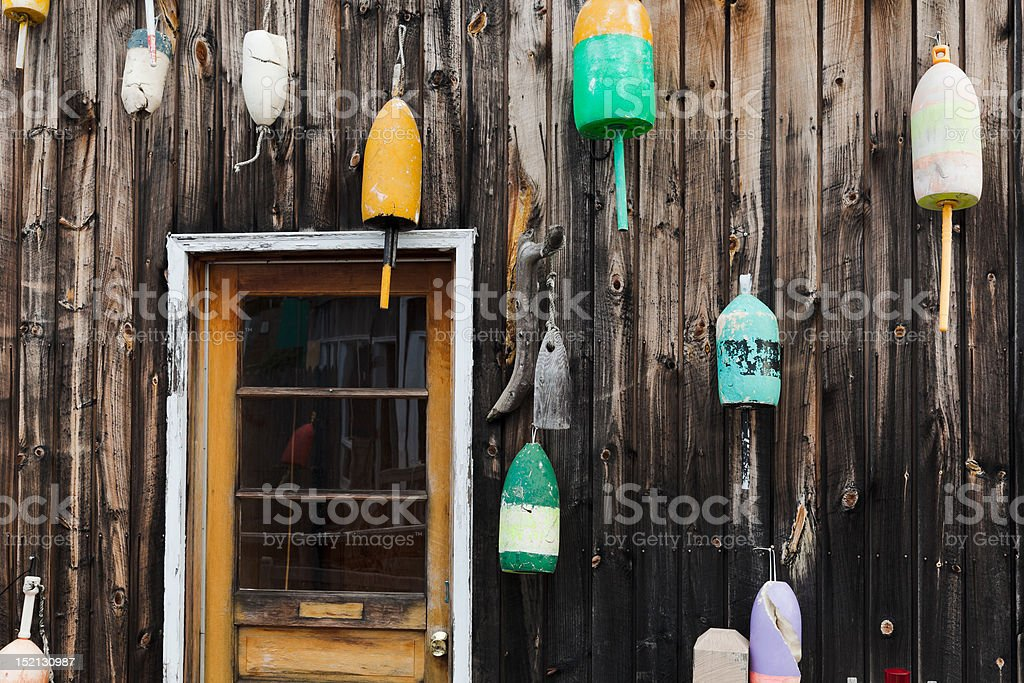 Old lobster floats on the wall stock photo