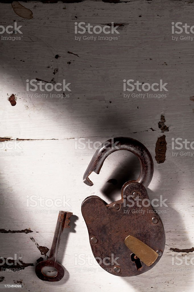 Old Lock and Key in a shaft of light. royalty-free stock photo
