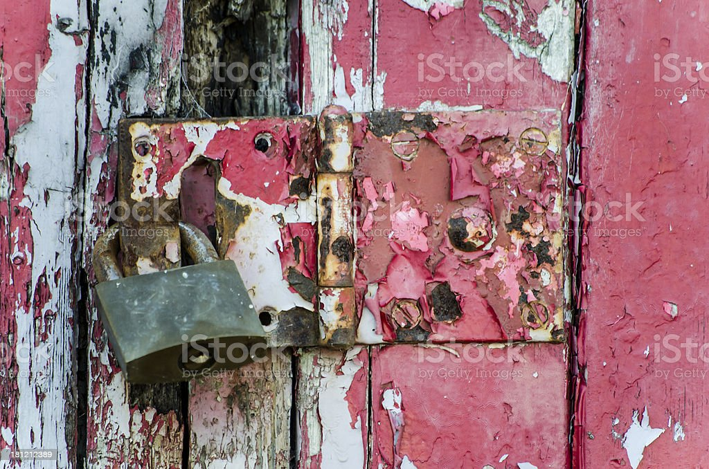 old lock on a weathered door royalty-free stock photo