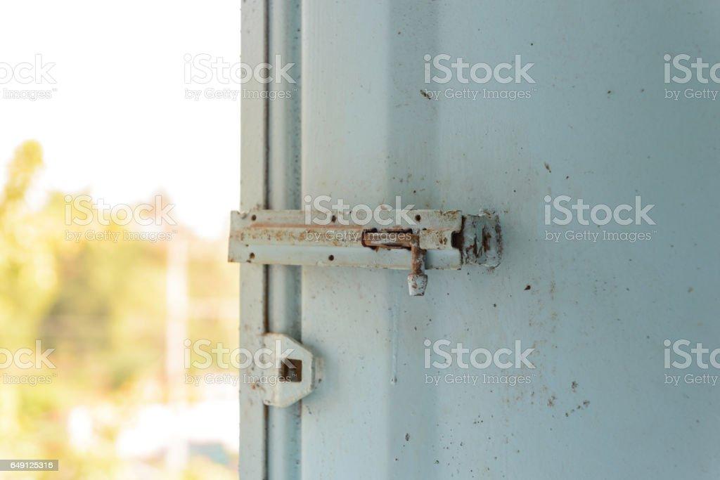 Old lock on the metal window. stock photo