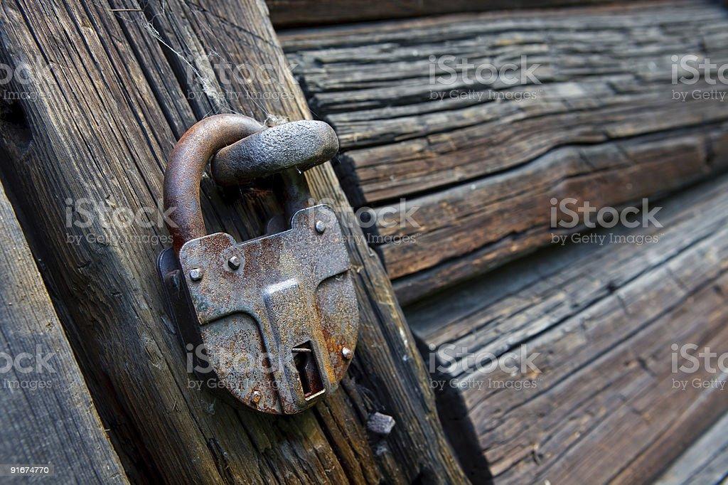 Old locked padlock royalty-free stock photo