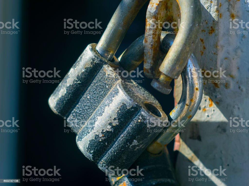 Old locks on the garage door stock photo