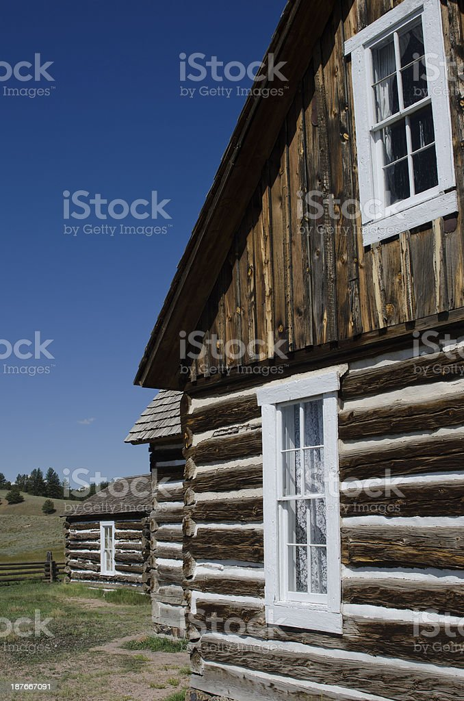 Old Log Cabin Windows and Lace Curtains stock photo