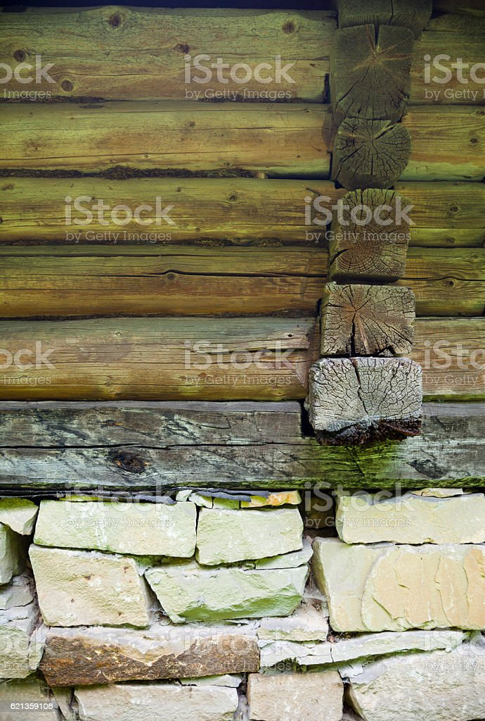 Old log house on the stone foundation stock photo