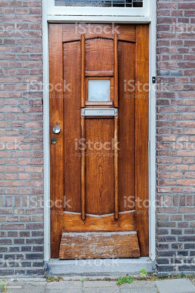 Old looking, light brown wooden door stock photo