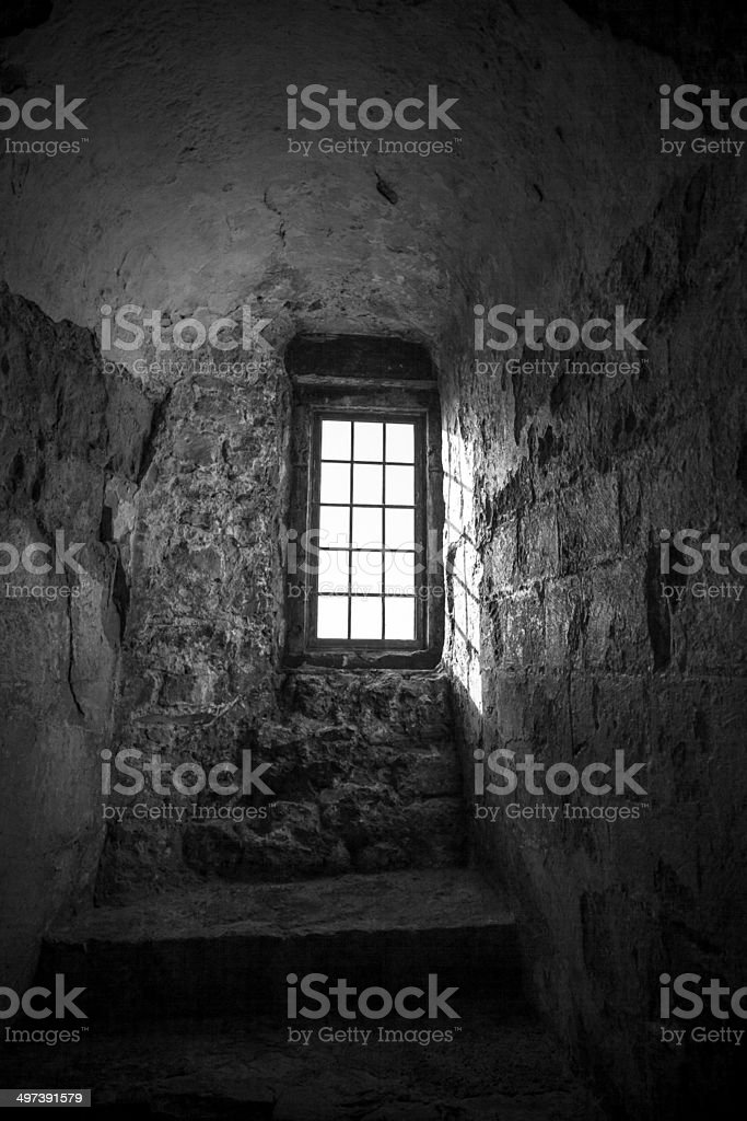 Old looking window in a brick wall stock photo