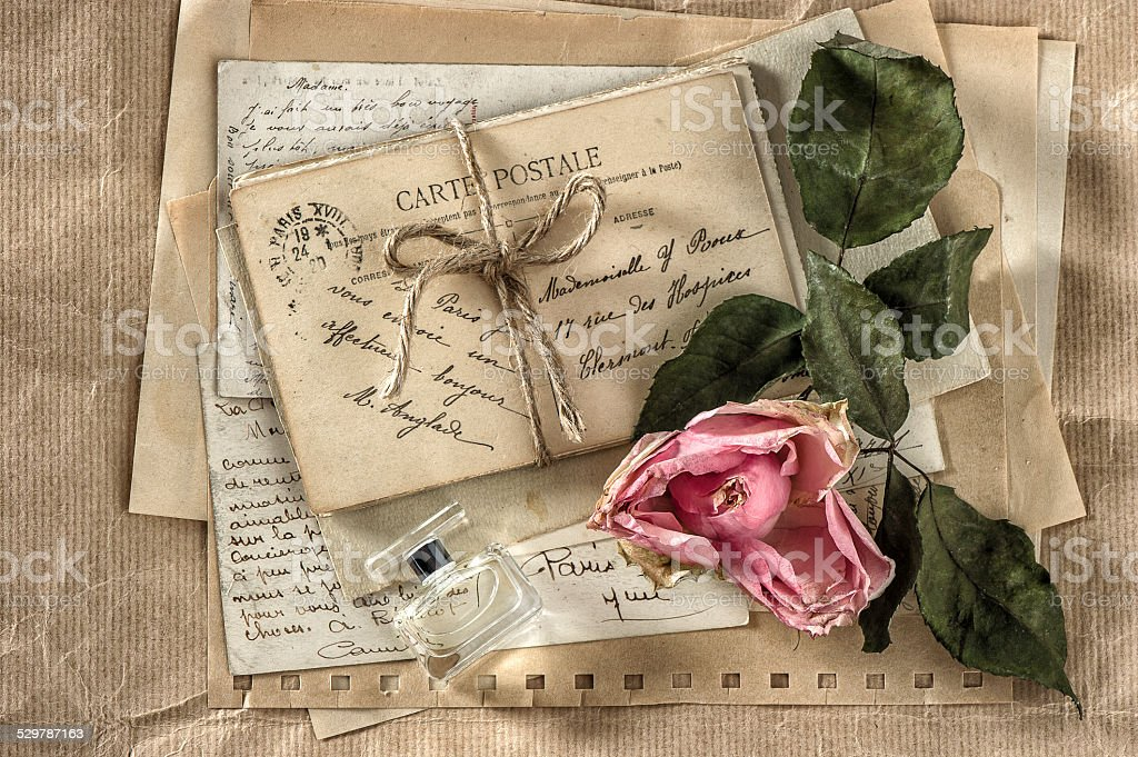 old love letters, perfume and dried rose flower. scrapbook paper stock photo