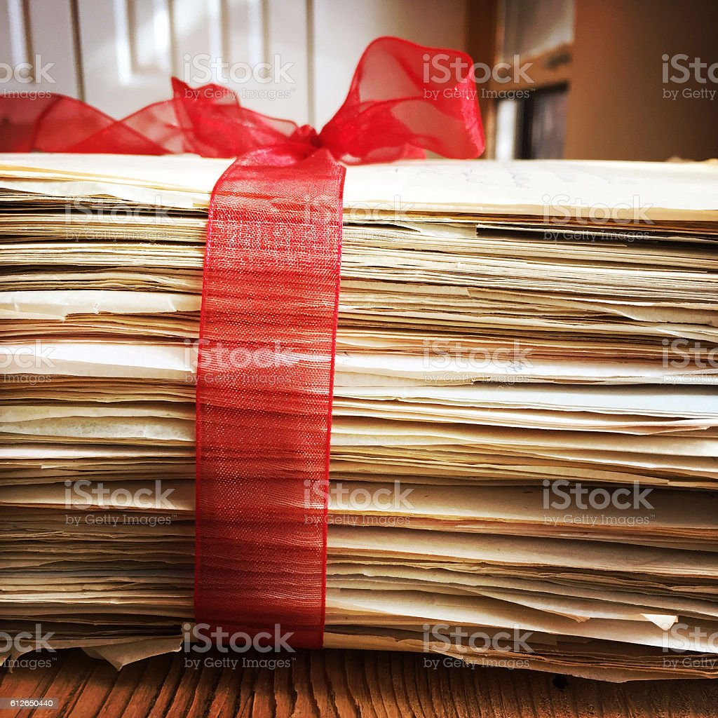 Old Love Letters tied with Red Ribbon stock photo
