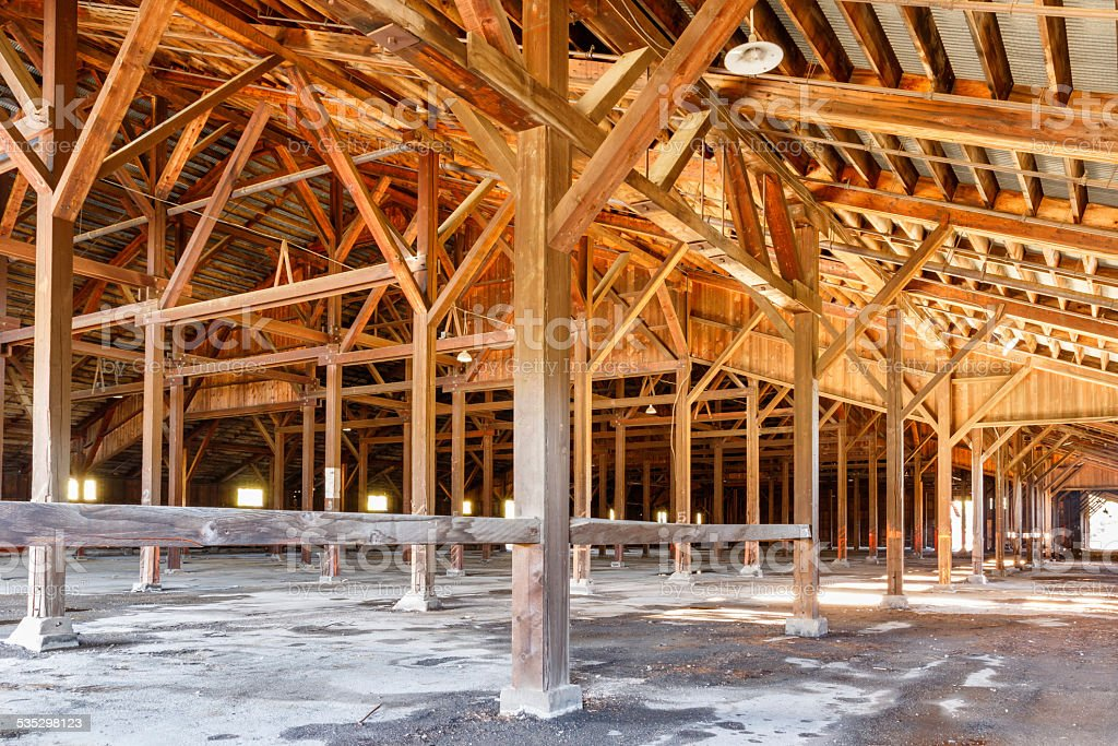 Old lumber mill hall stock photo