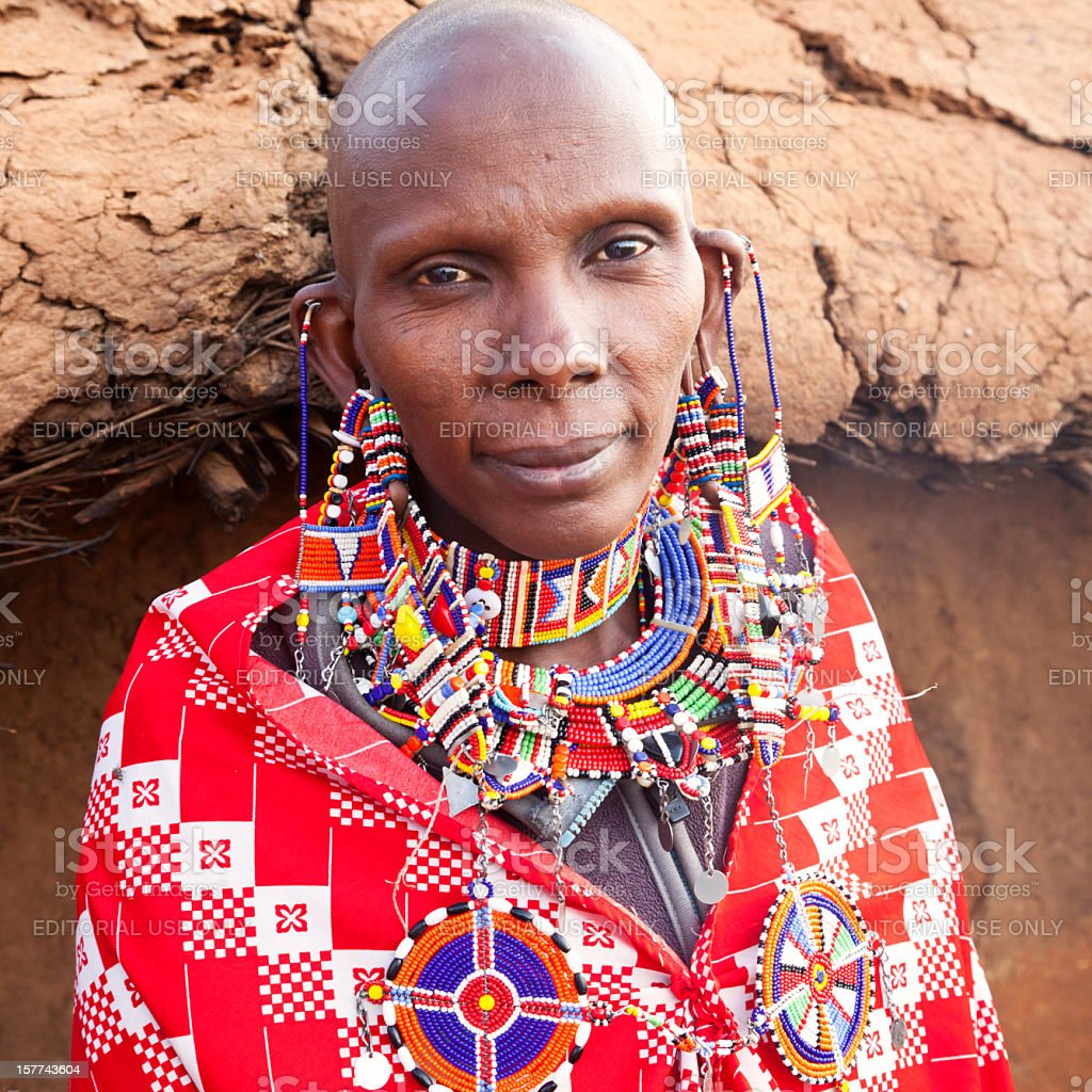 Old maasai woman with lots of traditional jevellery stock photo
