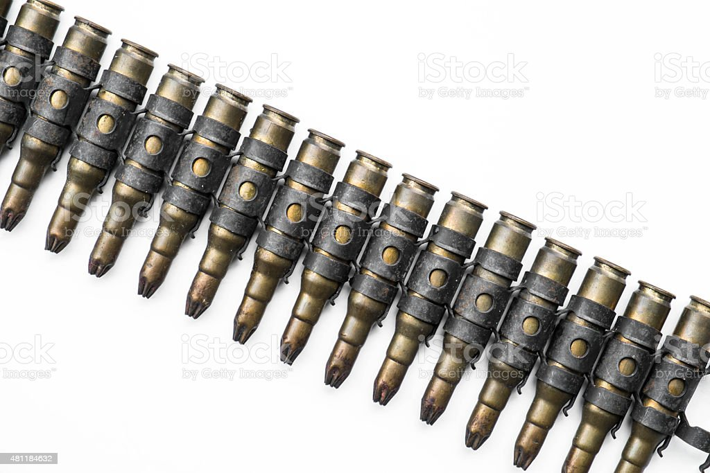 Old machine gun bullets on white background stock photo
