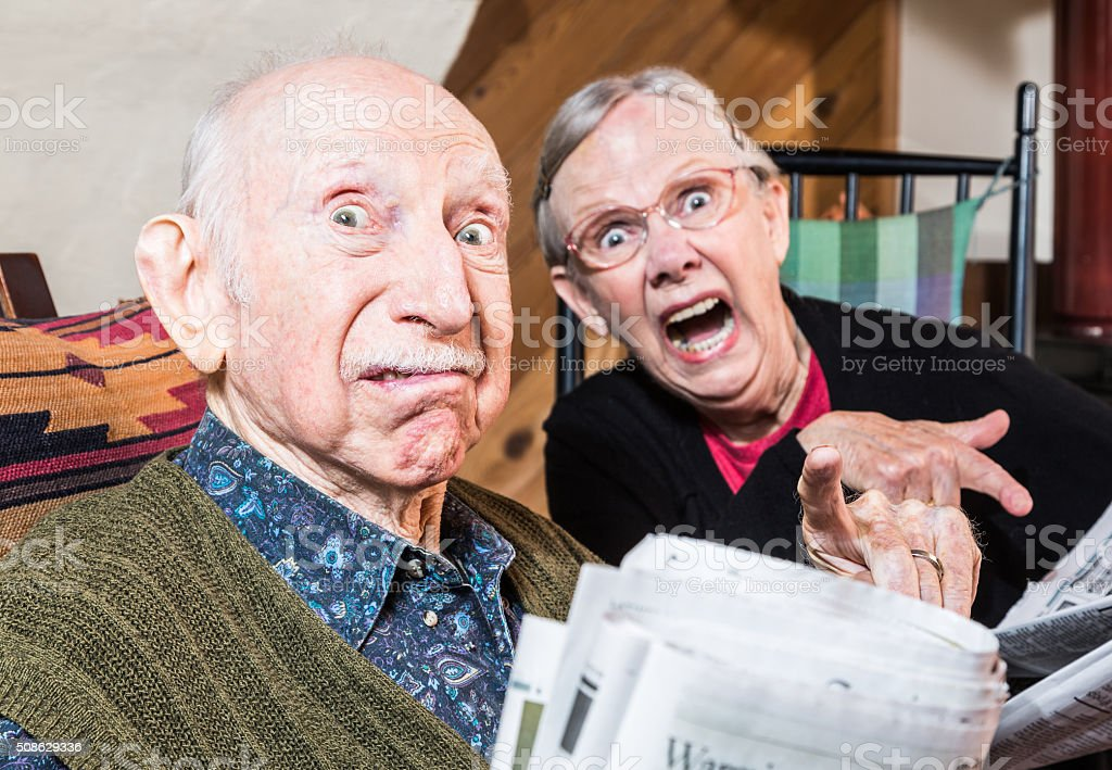Old Mad Couple with Newspaper stock photo
