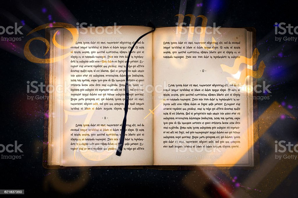 Old magic book with mysterious inscriptions stock photo