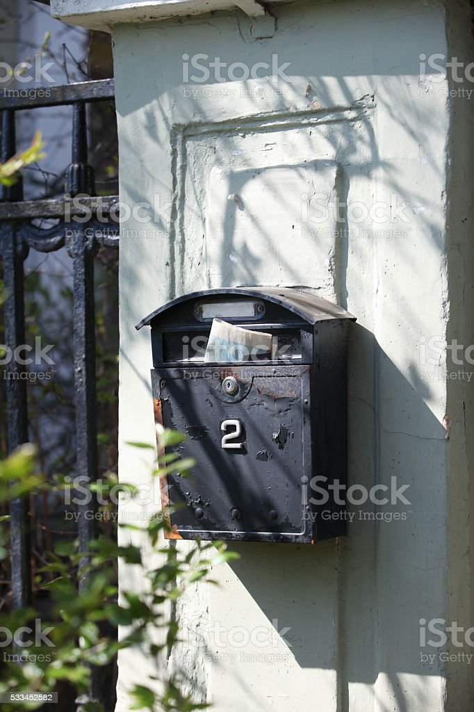 Old mailbox with newspaper stock photo