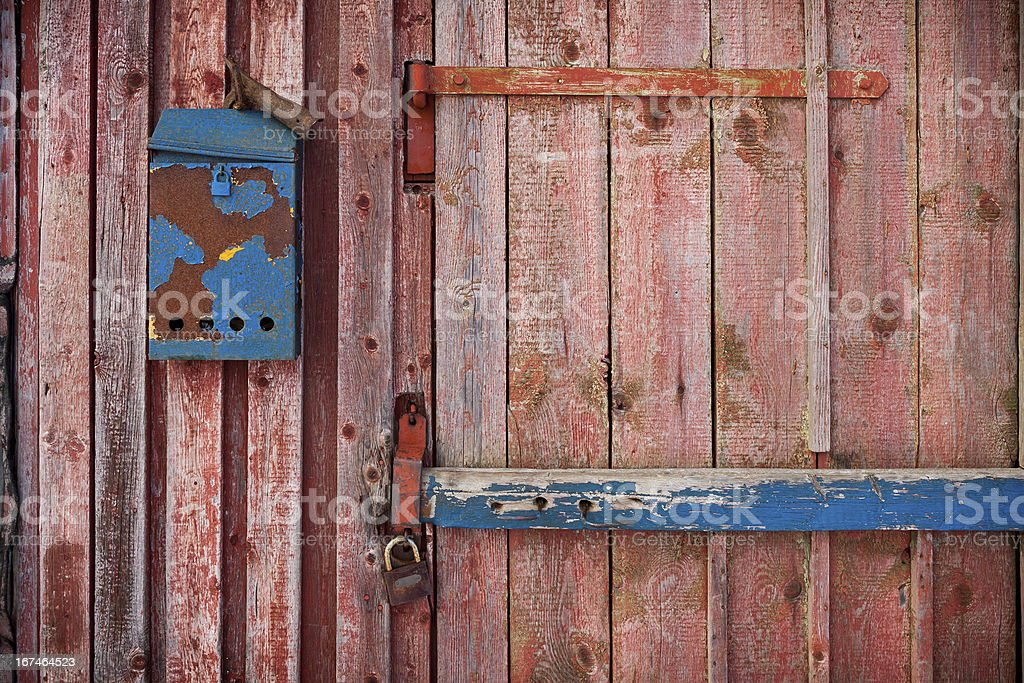 old mailboxe on an wooden door royalty-free stock photo