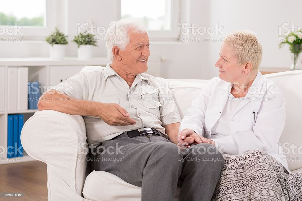 Old male having professional care stock photo