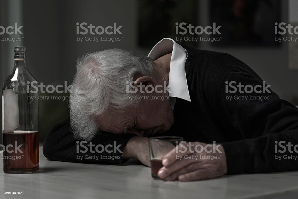 Old man alcoholic stock photo