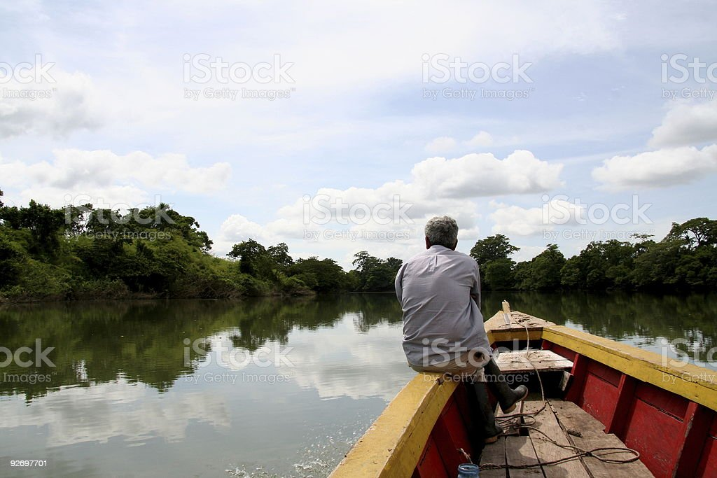 Old man and his boat royalty-free stock photo
