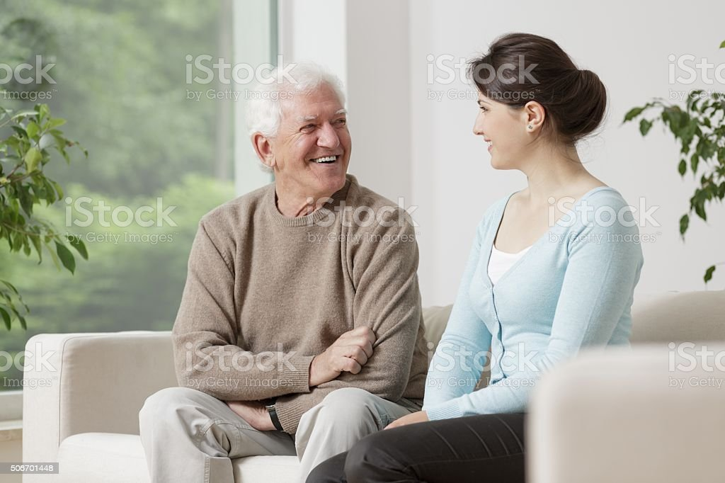 Old man and young woman stock photo