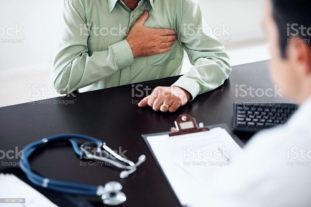 Old man at a routine medical checkup stock photo