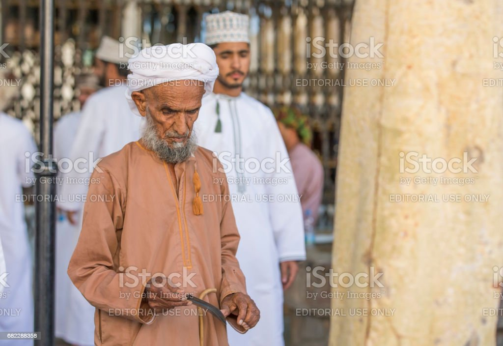Old man at Nizwa gun market stock photo