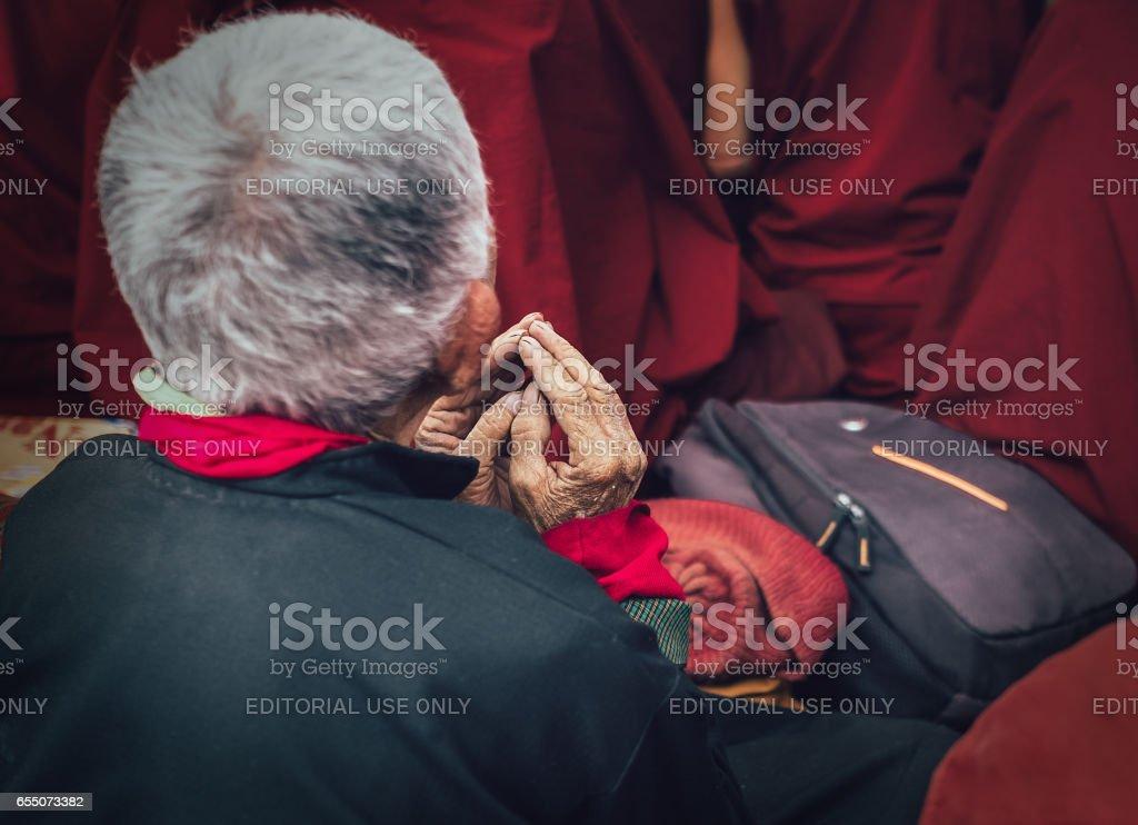 Old man buddhist monk's hands in prayer gesture stock photo