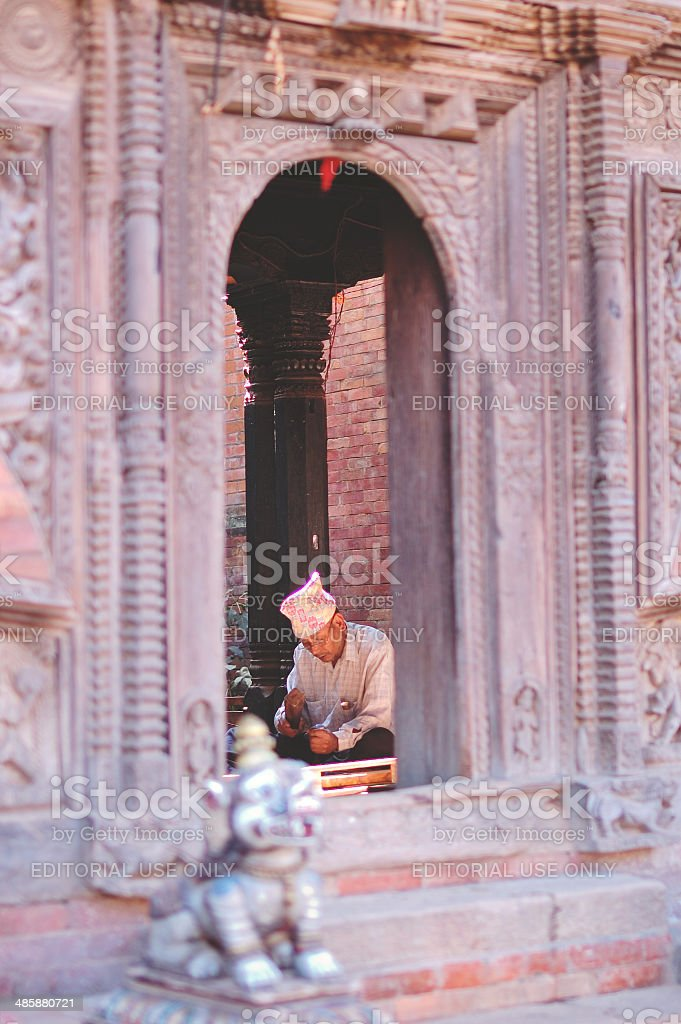 Old man carving in the house in Kathmandu royalty-free stock photo