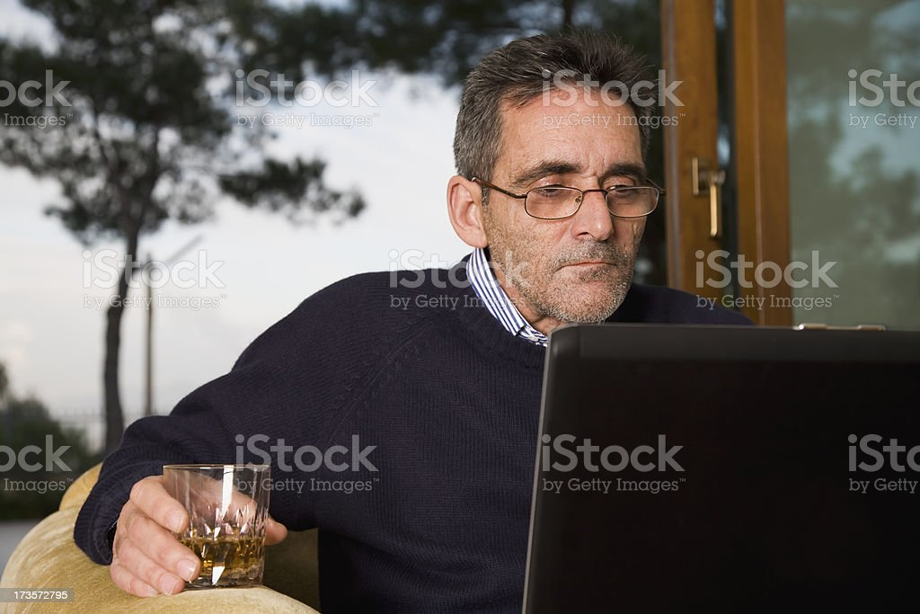 Old man concentrated on a laptop royalty-free stock photo