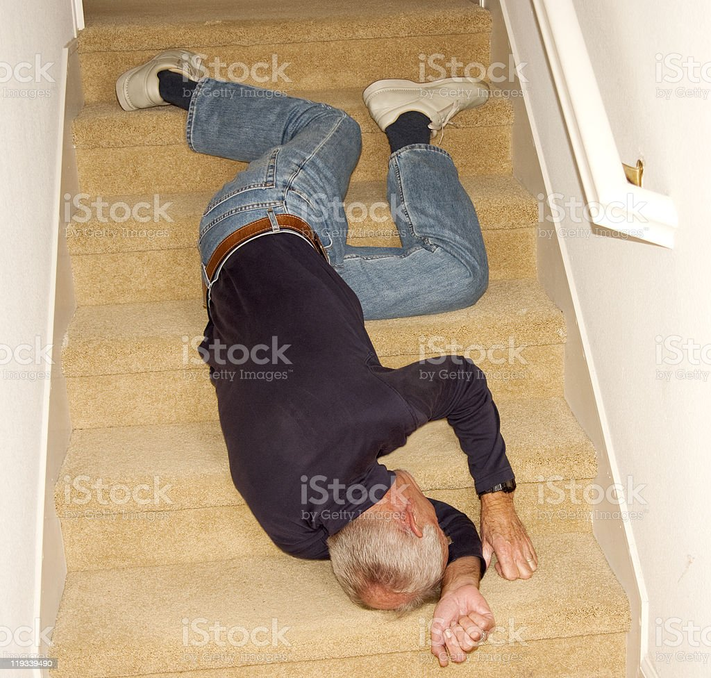 Old man fallen downstairs in home royalty-free stock photo