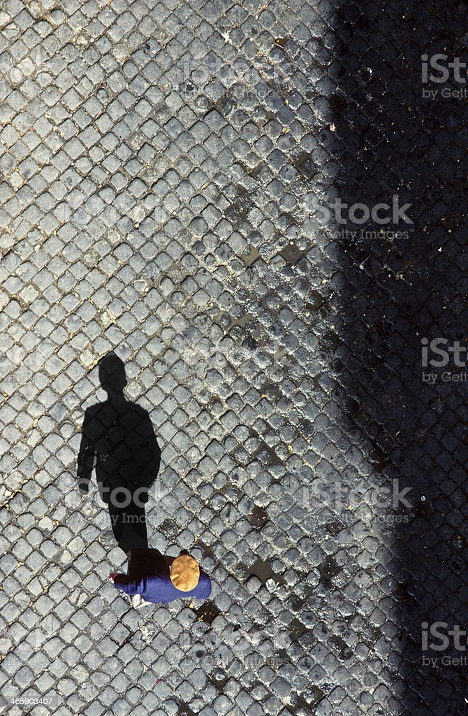 old man from birds view on cobble stone royalty-free stock photo